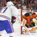 Philadelphia Flyers' Ray Emery (29) watches Montreal Canadiens' Alex Galchenyuk, left, during the first period of an NHL hockey game, Saturday, Oct. 11, 2014, in Philadelphia The Associated Press