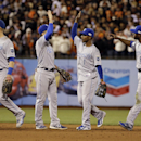 Kansas City Royals' Alex Gordon, left to right, Omar Infante, Jarrod Dyson and Lorenzo Cain celebrate after Game 3 of baseball's World Series against the San Francisco Giants Friday, Oct. 24, 2014, in San Francisco. The Royals won 3-2 to take a 2-1 lead in the series. (AP Photo/David J. Phillip)