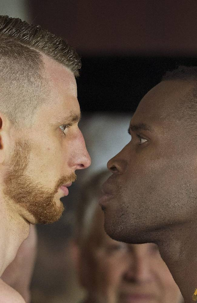 WBC light heavyweight boxing champion Adonis Stevenson, right, faces off with challenger Andrzej Fonfara during their weigh-in Friday, May 23, 2014, for Saturday's title fight, in Montreal