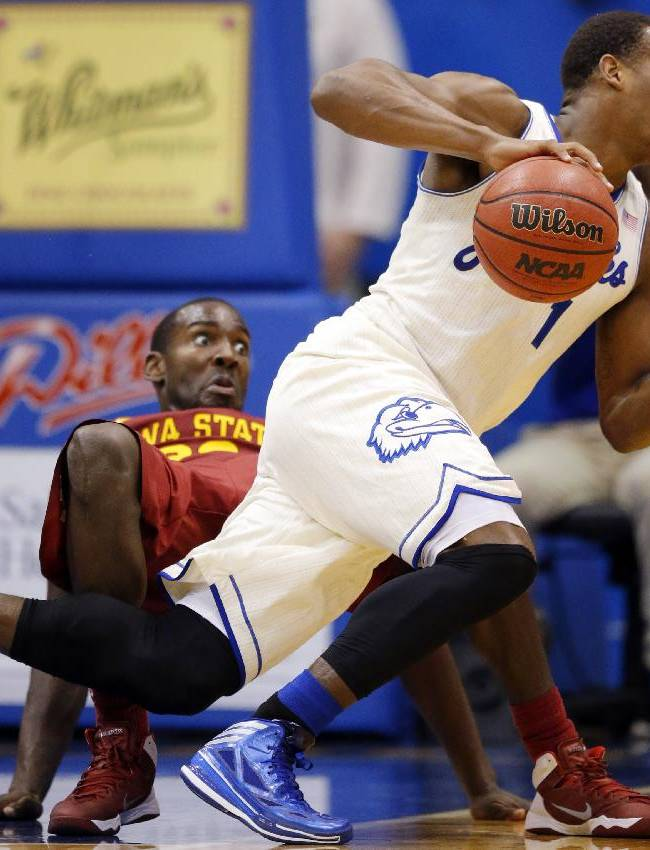 Kansas guard Wayne Selden, Jr. (1) is fouled by Iowa State forward Dustin Hogue, back, during the second half of an NCAA college basketball game in Lawrence, Kan., Wednesday, Jan. 29, 2014. Kansas won State 92-81