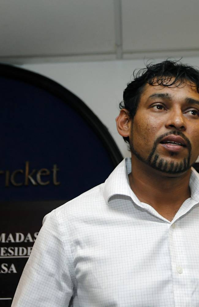 Ex-Sri Lankan cricket captain Tillakaratne Dilshan listens to a question raised by a reporter during a media briefing in Colombo, Sri Lanka, Thursday, Oct. 10, 2013. Dilshan announced his retirement from test cricket with immediate effect on Thursday, saying he wants to clear the way for younger players