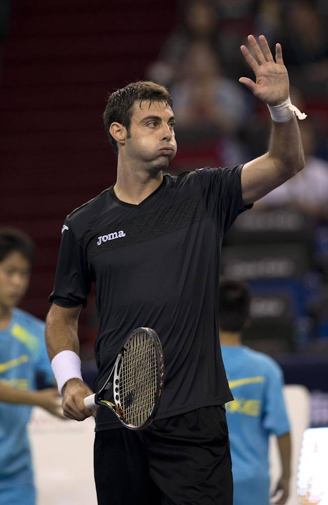Spain's Marcel Granollers celebrates after defeating Serbia's Janko Tipsarevic during a match at the Shanghai Masters Tennis tournament in the Qi Zhong Tennis Center in Shanghai, China on Monday, Oct. 7, 2013. Granollers won 6-4, 6-4