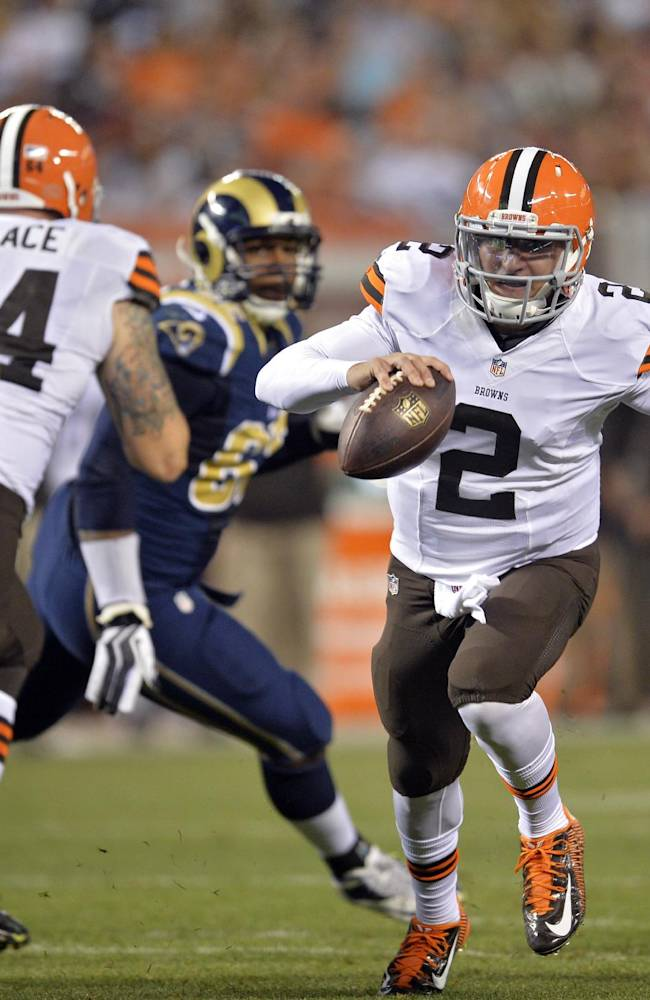 In this Aug. 23, 2014, file photo, Cleveland Browns quarterback Johnny Manziel (2) runs seven yards for a touchdown in the third quarter of a preseason NFL football game against the St. Louis Rams in Cleveland. Manziel doesn't view himself as the Browns' savior, but almost everyone else does. The dynamic rookie quarterback will begin the season as Cleveland's second-string quarterback, but it may not be long before he's moved ahead of Brian Hoyer, who already seems to be looking over his shoulder