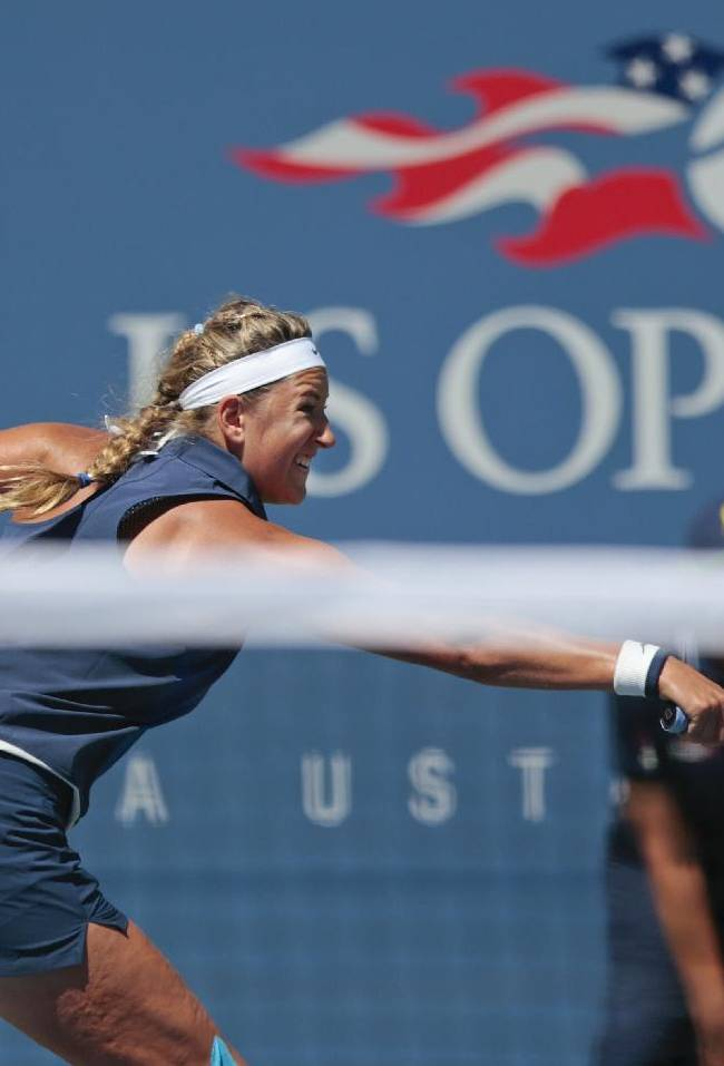 Victoria Azarenka, of Belarus, returns a shot against Ekaterina Makarova, of Russia, during the quarterfinals of the 2014 U.S. Open tennis tournament, Wednesday, Sept. 3, 2014, in New York