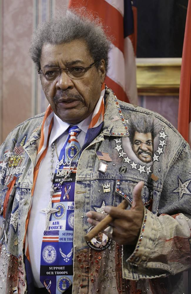 Promoter Don King answers questions during a news conference Tuesday, Feb. 11, 2014, in Cleveland. King was in Cleveland to promote a boxing event that will be held Feb. 21, 2014 in Cleveland. The boxing event will feature Angelo Santana (14-1, 11 KOs) vs. Hank Lundy (23-3-1, 11 KOs) in a 10-round lightweight main event