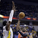 Milwaukee Bucks guard O.J. Mayo, center shoots between Indiana Pacers center Ian Mahinmi, left, and guard George Hill in the first half of an NBA basketball game in Indianapolis, Friday, Nov. 15, 2013 The Associated Press