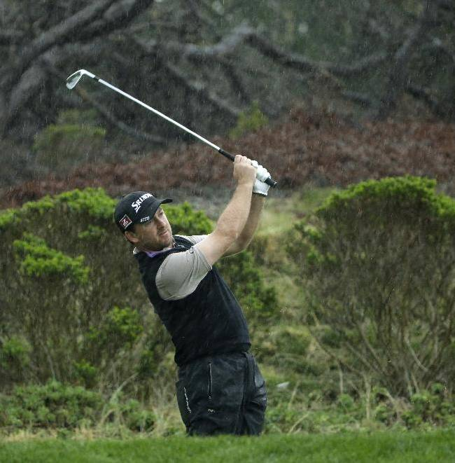 Graeme McDowell of Ireland hits off the third tee Thursday, Feb. 6, 2014, during the first round of the AT&T Pebble Beach Pro-Am golf tournament on the Spyglass Hill Golf Course in Pebble Beach, Calif