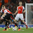 Arsenal's Jack Wilshere, top left, vies for the ball with Besiktas' Atiba Hutchinson during a second leg Champions League qualifying soccer match between Arsenal and Besiktas at Emirates Stadium in London Wednesday, Aug. 27, 2014.(AP Photo/Kirsty Wigglesw