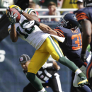 Green Bay Packers wide receiver Randall Cobb (18) makes a touchdown catch under pressure from Chicago Bears cornerback Isaiah Frey (31) in the first half of an NFL football game Sunday, Sept. 28, 2014, in Chicago. The Associated Press