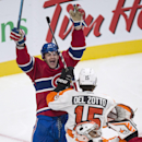Montreal Canadiens' Max Pacioretty celebrates a goal by teammate P.A. Parenteau past Philadelphia Flyers goalie Ray Emery during the third period of their NHL hockey game in Montreal on Saturday, Nov. 15, 2014 The Associated Press