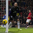 Manchester United's Ryan Giggs, right, narrowly fails to score past Everton's goalkeeper Tim Howard during their English Premier League soccer match at Old Trafford Stadium, Manchester, England, Wednesday Dec. 4, 2013