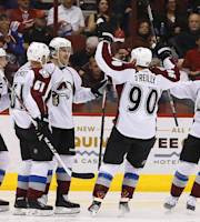 Colorado Avalanche's John Mitchell, center, celebrates his goal against the Phoenix Coyotes with teammates Nathan MacKinnon (29), Andre Benoit (61), P.A. Parenteau, right, during the second period of an NHL hockey game Thursday, Nov. 21, 2013, in Glendale, Ariz. (AP Photo/Ross D. Franklin)