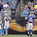Buffalo Bills' Anthony Dixon (26) celebrates his touchdown against the Carolina Panthers during the first half of a preseason NFL football game in Charlotte, N.C., Friday, Aug. 8, 2014 The Associated Press