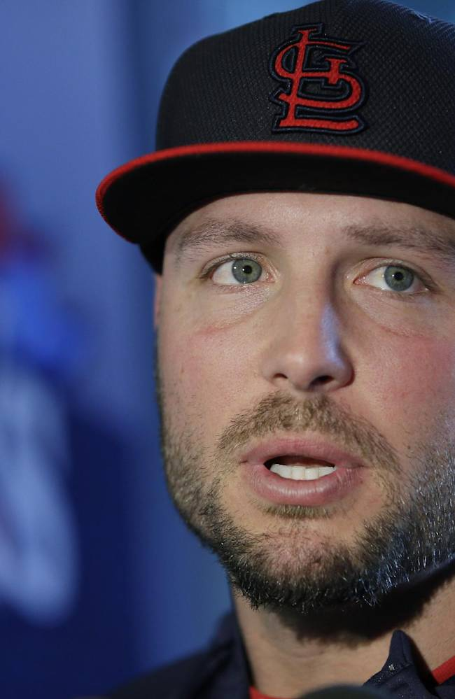 St. Louis Cardinals' Matt Holliday answers questions during a media availability for Game 1 of baseball's World Series against the Boston Red Soxwld Tuesday, Oct. 22, 2013, in Boston