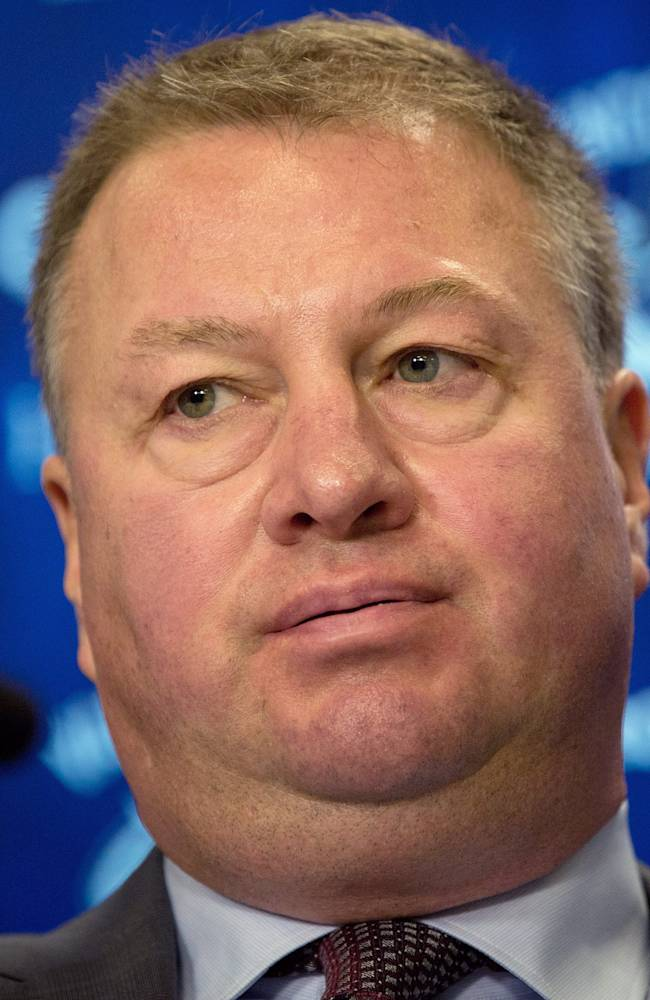 Vancouver Canucks President and General Manager Mike Gillis pauses while speaking to the media in Vancouver, British Columbia, on Thursday, May 9, 2013. The Canucks were eliminated from the NHL hockey 2013 Stanley Cup playoffs series in four games by the San Jose Sharks