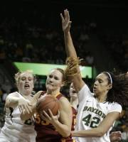 Iowa State forward Chelsea Poppens, center, attempts to get through Baylor  defenders Ashley Field, left, and Brittney Griner (42) for a shot in the first half of an NCAA college basketball game Saturday, March 3, 2012, in Waco, Texas. (AP Photo/Tony Gutierrez)