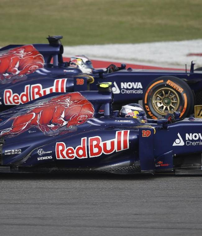 Toro Rosso driver Daniel Ricciardo of Australia, foreground, and teammate Daniel Ricciardo of Australia race side by side during the first practice session for the Formula One U.S. Grand Prix auto race at the Circuit of the Americas, Friday, Nov. 15, 2013, in Austin, Texas