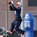 New England Patriots defensive back Justin Green leaps for a pass during an NFL football practice in Foxborough, Mass., Wednesday, Dec. 17, 2014 The Associated Press
