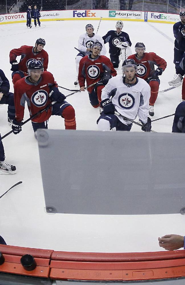 The Winnipeg Jets hit the ice at MTS Centre for practice on the fourth day of NHL hockey training camp on Saturday, Sept. 14, 2013, in Winnipeg, Manitoba