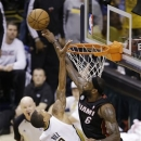 Miami Heat's LeBron James, right, blocks a shot by Indiana Pacers' George Hill during the second half of Game 4 of the NBA basketball Eastern Conference finals, Tuesday, May 28, 2013, in Indianapolis. (AP Photo/AJ Mast)