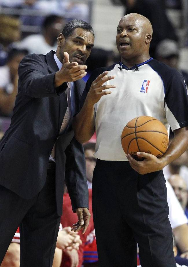 Detroit Pistons coach Maurice Cheeks, left, argues a call with NBA official Olandis Poole in the first half of an NBA basketball preseason game on Thursday, Oct. 10, 2013, in Detroit