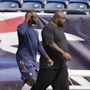 New England Patriots defensive tackle Vince Wilfork, right, and linebacker Ja'Gared Davis (53) walk onto the field for a walk-through at the NFL football team's facility Tuesday, Oct. 14, 2014 in Foxborough, Mass. The Patriots will play the New York Jets