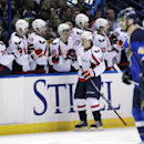 Washington Capitals' Mikhail Grabovski (84) celebrates with teammates on the bench after scoring a goal during the second period of an NHL hockey game against the St. Louis Blues, Tuesday, April 8, 2014, in St. Louis The Associated Press