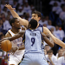 Oklahoma City Thunder forward Kevin Durant (35) is double teamed by Memphis Grizzlies center Marc Gasol and guard Tony Allen (9) in the second quarter of Game 5 of an opening-round NBA basketball playoff series in Oklahoma City, Tuesday, April 29, 2014. (AP Photo)