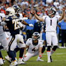 Denver Broncos kicker Connor Barth (1) watches his 49-yard field goal with teammate punter Britton Colquitt during the second half of an NFL football game against San Diego Chargers, Sunday, Dec. 14, 2014, in San Diego The Associated Press