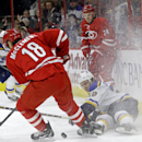 St. Louis Blues' Kevin Shattenkirk (22) falls to the ice while chasing the puck against Jay McClement (18) and Brad Malone (24) during the second period of an NHL hockey game in Raleigh, N.C., Friday, Jan. 30, 2015 The Associated Press