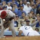 Los Angeles Dodgers' Matt Kemp, right, steals third base as Arizona Diamondbacks third baseman Martin Prado fields the throw during the fifth inning of a baseball game on Saturday, April 19, 2014, in Los Angeles The Associated Press