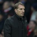 Liverpool's manager Brendan Rodgers walks from the pitch after his team's 3-0 loss during the English Premier League soccer match between Manchester United and Liverpool at Old Trafford Stadium, Manchester, England, Sunday Dec. 14, 2014