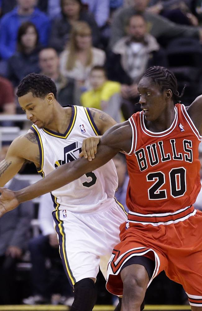 Burke, Jazz beat Rose-less Bulls, 89-83 in OT