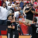 D.C. United midfielder Luis Silva, left, celebrates with Fabian Espindola (9), and Davy Arnaud (8), after Silva's goal during the second half of an MLS soccer match against the New York Red Bulls, at RFK Stadium, Sunday, Aug. 31, 2014, in Washington. Unit
