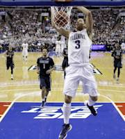 Villanova's Josh Hart dunks the ball during the first half of an NCAA college basketball game against Georgetown, Saturday, March 8, 2014, in Philadelphia. (AP Photo/Matt Slocum)