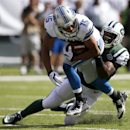Detroit Lions wide receiver Golden Tate (15) is tackled by New York Jets inside linebacker David Harris (52) during the first half of an NFL football game, Sunday, Sept. 28, 2014, in East Rutherford, N.J. The Associated Press