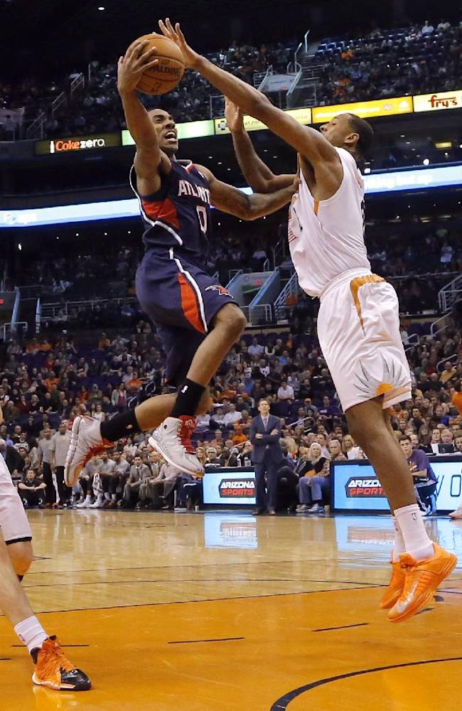 Atlanta Hawks' Jeff Teague (0) is fouled by Phoenix Suns' Channing Frye, center, as teammates Goran Dragic, of Slovenia, left, and Gerald Green watch during the first half of an NBA basketball game, Sunday, March 2, 2014, in Phoenix