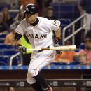 Miami Marlins' Ichiro Suzuki dodges a ball while batting during the seventh inning of a baseball game against the Baltimore Orioles in Miami, Friday, May 22, 2015. (AP Photo/J Pat Carter)