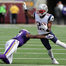 New England Patriots cornerback Logan Ryan, right, tries to avoid Minnesota Vikings wide receiver Jarius Wright after intercepting a pass during the third quarter of an NFL football game Sunday, Sept. 14, 2014, in Minneapolis. (AP Photo/Jim Mone)