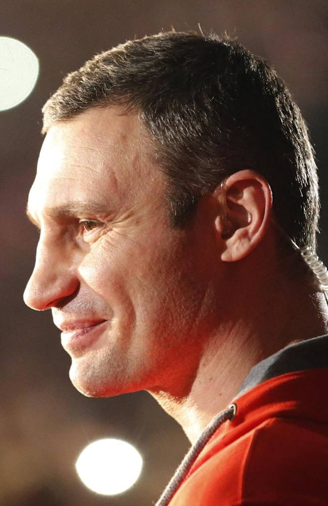 Ukrainian politician Vitali Klitschko smiles before the IBF, WBA, WBO and IBO tile bout of his brother Wladimir Klitschko in Oberhausen, western Germany, Sunday, April 27, 2014