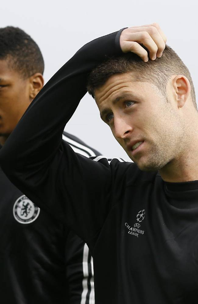 Chelsea's Gary Cahill touches his head as he arrives for a training session at their training ground in Cobham, Surrey, England, Tuesday, Sept. 17, 2013. Chelsea will play FC Basel in a Champions League match at Stamford Bridge on Wednesday