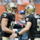 New Orleans Saints tight end Jimmy Graham (80) is congratulated by quarterback Drew Brees (9) after they connected on a 9-yard touchdown against the Cleveland Browns in the second quarter of an NFL football game Sunday, Sept. 14, 2014, in Cleveland The As