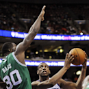 Philadelphia 76ers' Thaddeus Young (21) looks for room to shoot while Boston Celtics' Brandon Bass defends during the second half of an NBA basketball game on Monday, April 14, 2014, in Philadelphia. The 76ers won 113-108 The Associated Press