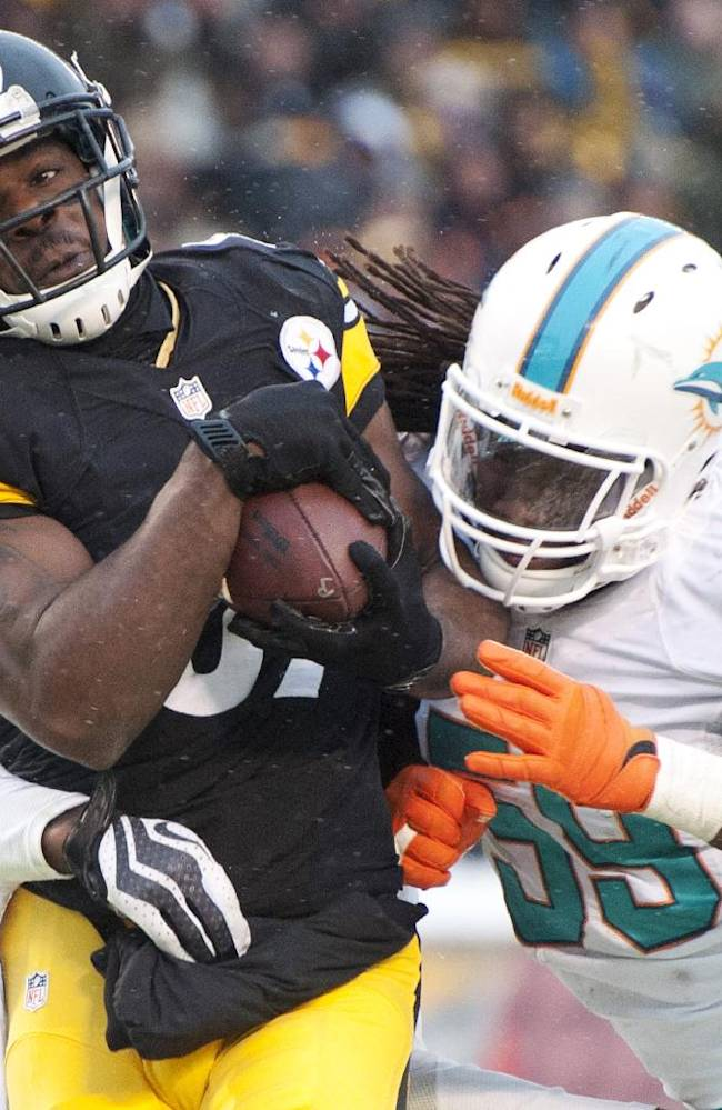 Pittsburgh Steelers wide receiver Jerricho Cotchery (89) gets past Miami Dolphins middle linebacker Dannell Ellerbe (59) for a touchdown during the second half of an NFL football game in Pittsburgh, Sunday, Dec. 8, 2013
