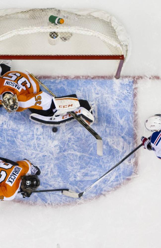 Philadelphia Flyers' Steve Mason, top, makes a pad-save as Jakub Voracek, bottom center, of the Czech Republic, looks to help with New York Rangers' Ryan McDonagh, bottom left, and Rick Nash, bottom right, looking for the rebound during the first period in Game 4 of an NHL hockey first-round playoff series on Friday, April 25, 2014, in Philadelphia