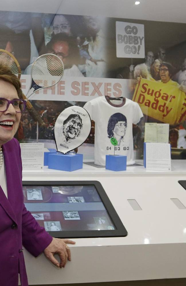 In this photo taken Sept. 5, 2013, Billie Jean King reflects about her match against Bobby Riggs in 1973 as she stands in front of a display during the U.S. Open tennis tournament in New York. Friday, Sept. 20, 2013, is the 40th anniversary of Kings's straight-set victory over Riggs in front of more than 30,000 fans
