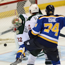 Minnesota Wild's goalie Niklas Backstrom of Finland (32) is scored on by St. Louis Blues' T.J. Oshie (74) as Wild's Cody Almond watches during the third period of a preseason NHL hockey game, Thursday, Oct. 2, 2014, in St. Louis The Associated Press