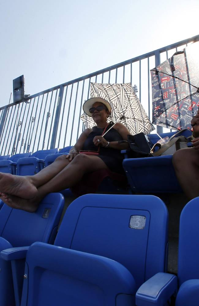 Beulah Ingram, left, and her daughter Paris Ingram watch play between Simona Halep, of Romania, during the second round of the 2014 U.S. Open tennis tournament, Wednesday, Aug. 27, 2014, in New York