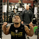Arizona State football player Zach Abdorrahimzadeh lifts weights under the watchful eyes of Shawn Griswold, back right, Arizona State's head coach of sports performance, at the football training room on Monday, July 21, 2014, in Tempe, Ariz The Associated
