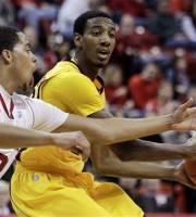 Minnesota's Austin Hollins, right, is defended by Nebraska's Toney McCray in the first half of their NCAA college basketball game in Lincoln, Neb., Sunday, Feb. 5, 2012. (AP Photo/Nati Harnik)